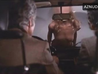 B. Bouchet in 1972 movie in yellow panties stripping